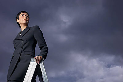 Business woman climbing career ladder